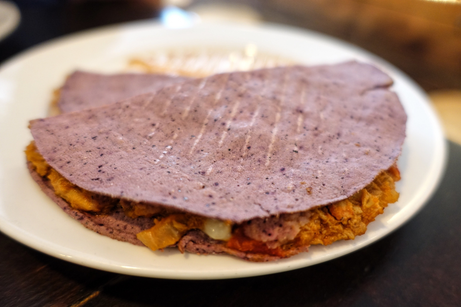 Chipotle chicken and mozzarella quesadillas in blue corn tortillas at Condesa in London