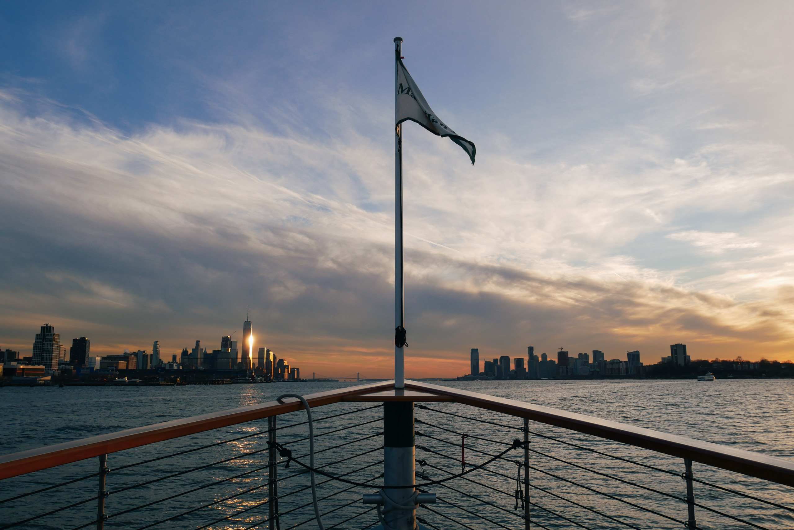 The New York skyline at sunset from a Manhattan cruise yacht